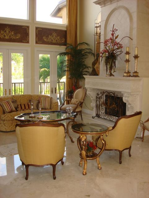 Traditional Family Room with white marble tile fire place facing