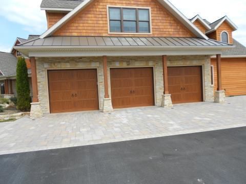 Lodge Garage with stained wood shingle siding