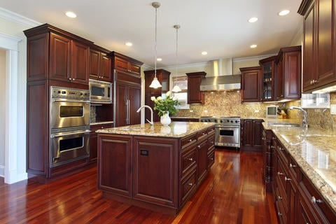 Traditional Kitchen with large island with granite countertop