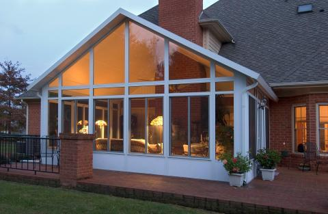 Traditional Sunroom with floor to ceiling windows
