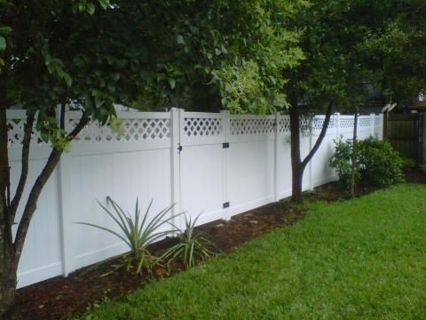 Transitional Landscape with flower garden lining fence