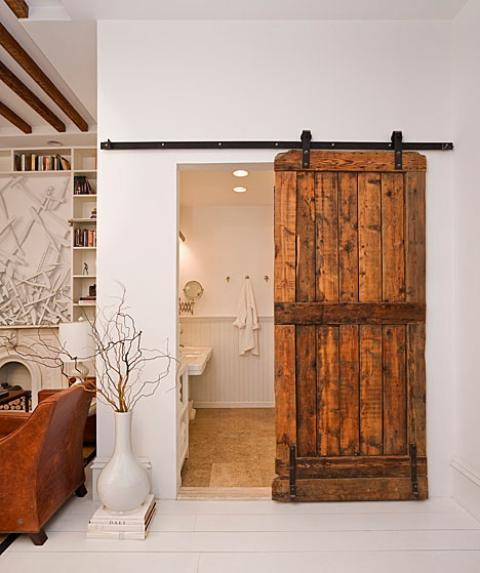 Rustic Bathroom with built in shelves around fire place