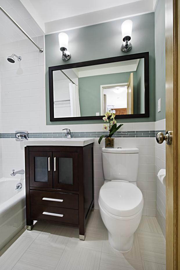 Contemporary Bathroom with dark brown bathroom vanity with white porcelain  countertop