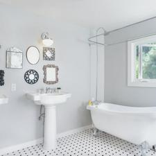 Eclectic Bathroom with white and black tiled floor
