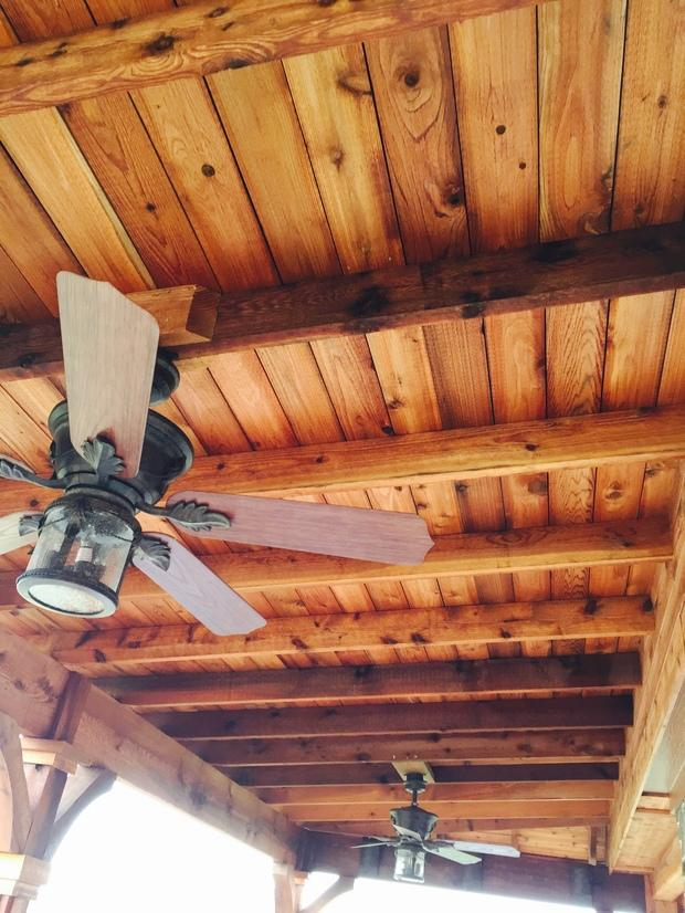 Rustic Porch With Western Red Ceiling Fan Paddles