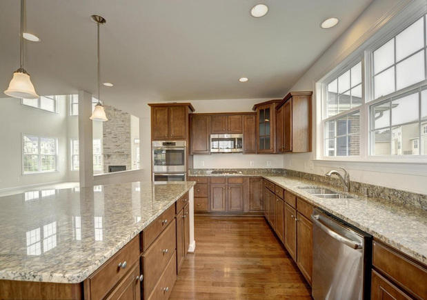 Transitional Kitchen In Sterling Medium Wood Cabinets Stainless Steel Sink By Home Design