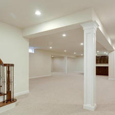 Traditional Basement with white walls and trim