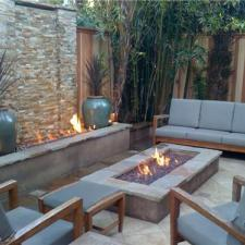 Transitional Patio with built-in fire pit with water fall feature