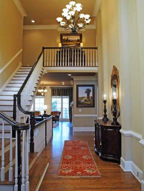 Traditional Entry with black metal hanging chandelier