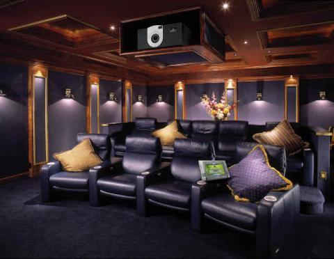 Transitional Home Theater with black leather recliner chairs