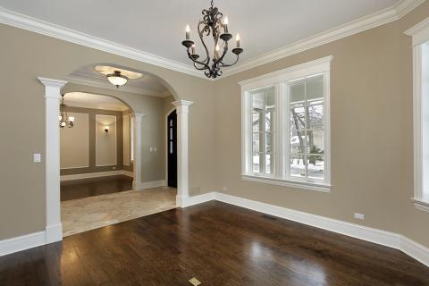 Traditional Family Room with dark hardwood flooring