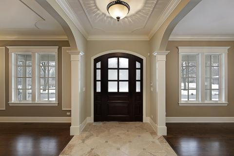English Entry with light tan stone tile accent flooring