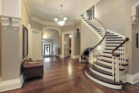 Traditional Entry with dark stained handrails