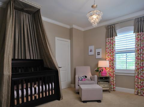 Modern Kids Room with dark gray curtain over baby crib