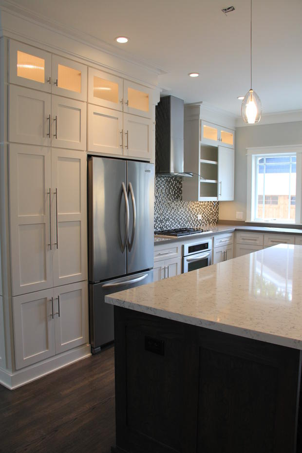 Transitional Kitchen with glass display cabinet doors