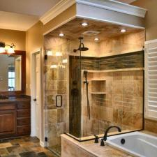 Traditional Bathroom with tan porcelain tile shower wall covering