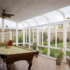 Traditional Sunroom with brown ceramic tile floor