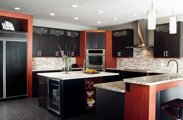 Modern Kitchen with built-in refrigerator with black wooden detail