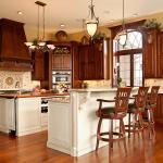 French Country Kitchen with kitchen island with wooden counter top