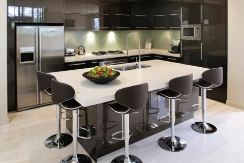 Modern Kitchen with chrome and black bar stool