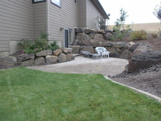 Contemporary Patio with large landscape boulders lining patio