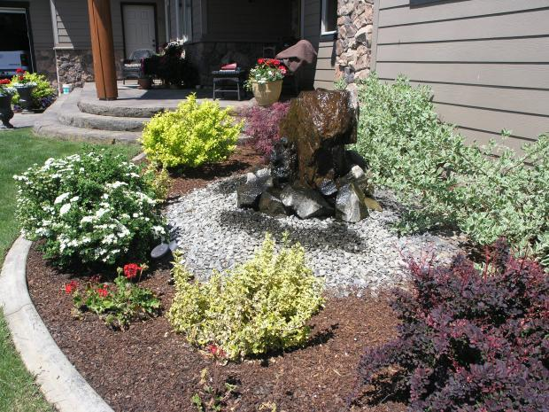 Transitional Garden with large stone water fall feature