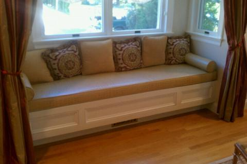 Traditional Family Room with white wood built-in window bench seating