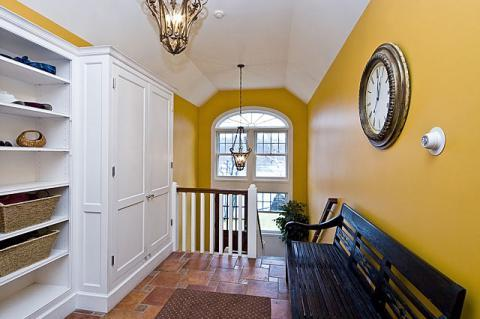 Eclectic Entry with large rounded window in stairs