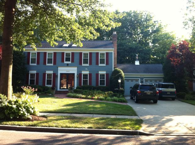 Colonial Home Exterior In Annandale Blue Siding White