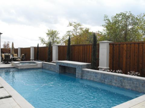 Transitional Pool with cobblestone patio surround