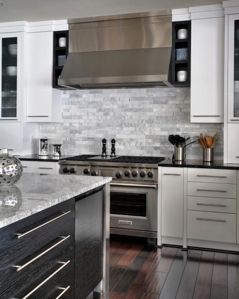 Transitional Kitchen with large kitchen island with light gray marble counter tops