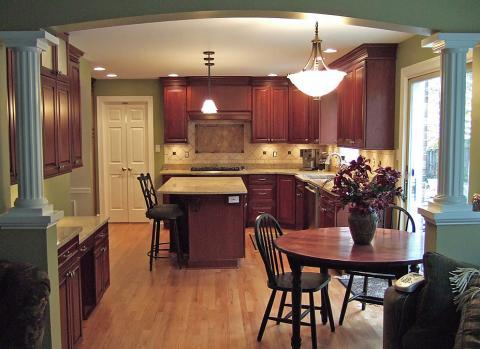 Traditional Kitchen with cherrywood stained cabinets