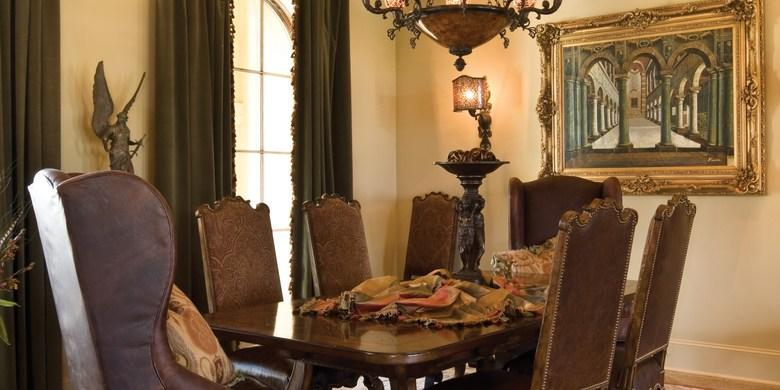 Traditional Dining Room with dark brown leather dining chairs