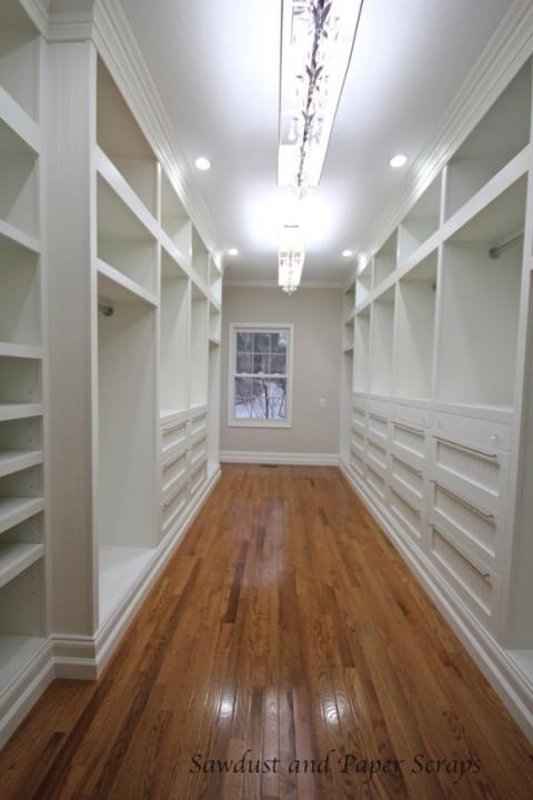 Traditional Closet with white wood storage units