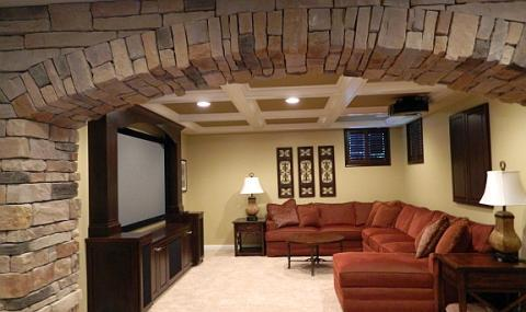 Traditional Family Room with dark wood built-in wall hung cabinet