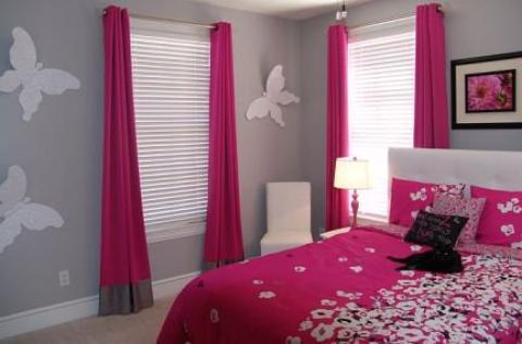 Contemporary Kids Room with bright pink duvet cover with flower accents