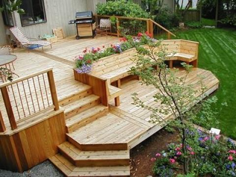 Traditional Patio with wood and metal guard rail