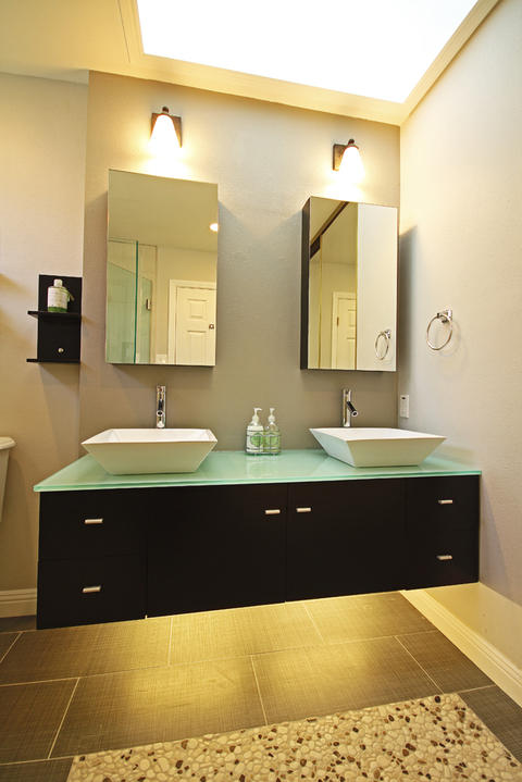 Contemporary Bathroom with lights underneath vanity cabinets