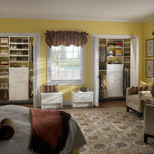 Transitional Bedroom with beige upholstered chairs