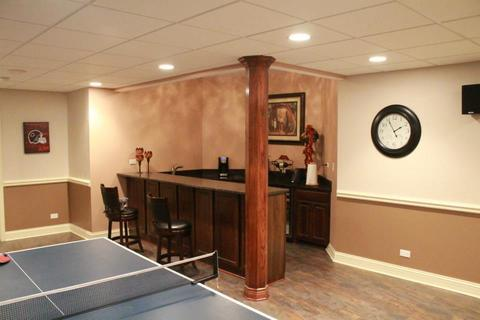 Traditional Basement with open basement with wet bar area