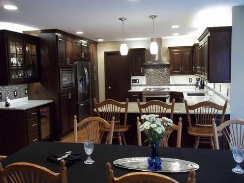 Traditional Dining Room with dark mosaic tile back splash