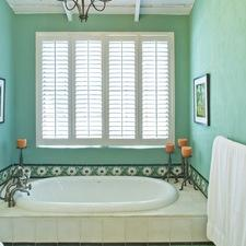 Eclectic Bathroom with white plantation shutters