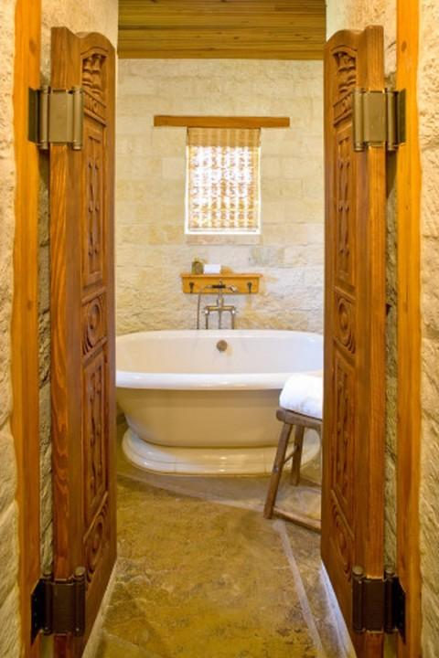 Eclectic Bathroom with beautifully decorated wooden doors