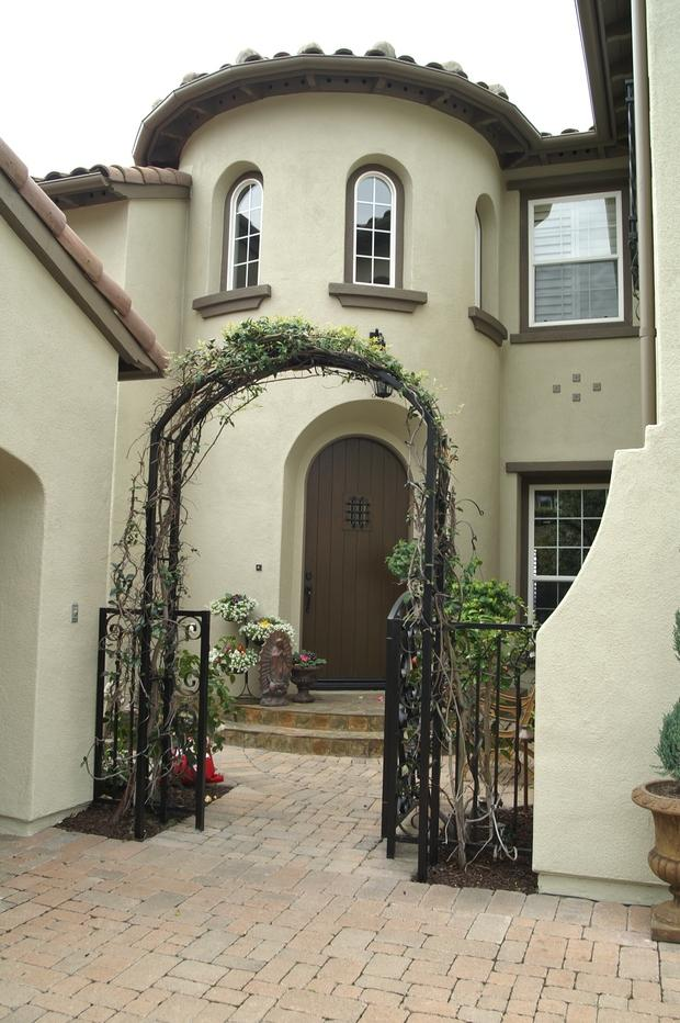 Mediterranean Home Exterior In San Clemente Arched Wood Door Double Hung Windows By Im
