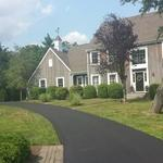Cape Cod Home Exterior with grey asphalt shingle roof