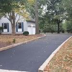 Traditional Driveway with asphalt driveway