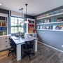 Contemporary Craft Room with built-in bookshelves