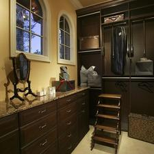 Traditional Closet with beige granite countertops