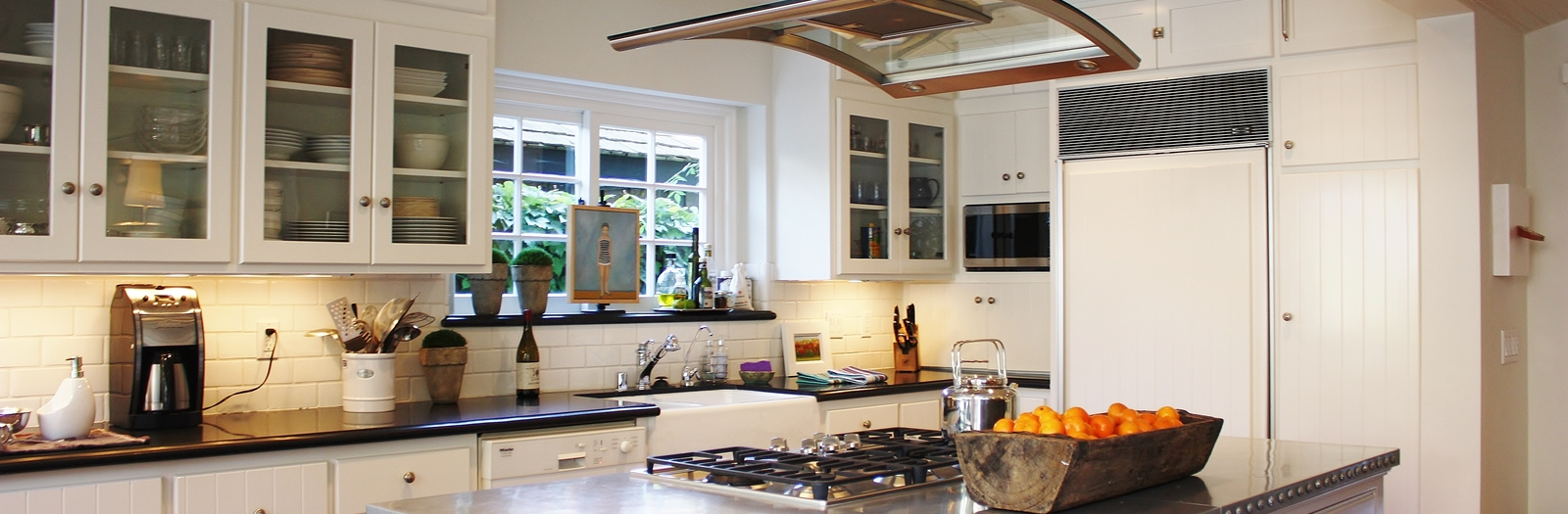 Transitional Kitchen with glass and stainless steel range hood