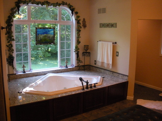French country bathroom in lafayette large curved window for Bath remodel lafayette la